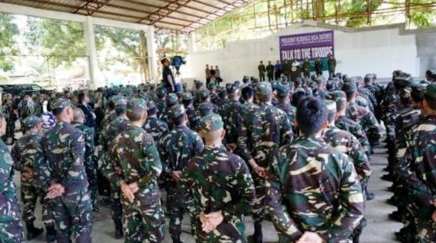 President Rodrigo Duterte talks to the troops of Joint Task Force Sulu prior to his visit to wounded soldiers at Camp Teodulfo Bautista in Jolo, Sulu on May 27, 2017. He tells troops they can rape up to three women each with impunity.  PCOO/Released