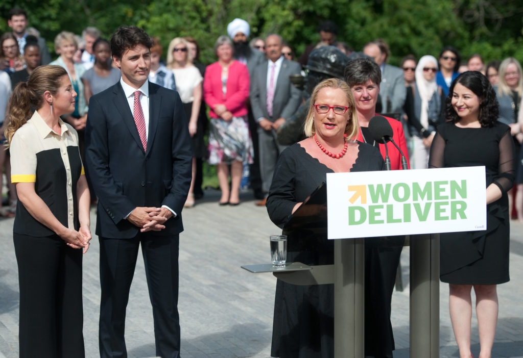 Sophie Grégoire, Justin Trudeau, Marie-Claude Bibeau and Maryam Monsef listening to Katja Iversen announcing that the Women Deliver 2019 Conference will be in Vancouver