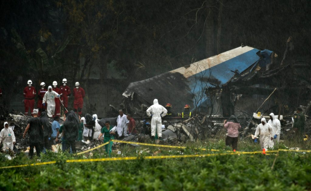Rescuers searching through the wreckage of a Boeing 737 that crashed with more than 100 passengers on board near Havana on Friday. Credit Ramon Espinosa/Associated Press