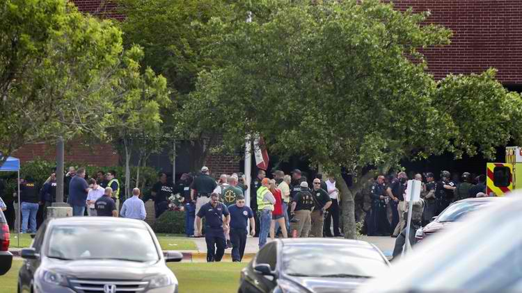 Law enforcement officers respond to an active shooter in front of Santa Fe High School Friday, May 18, 2018, in Santa Fe, Texas. (Steve Gonzales / AP)
