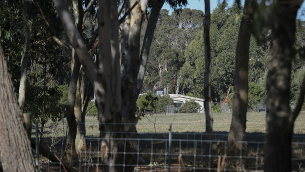 A property is seen from a police roadblock where police are investigating the death of seven people in a suspected murder-suicide in Osmington, east of Margaret River on Friday, May 11, 2018. (Richard Wainwright/AAP Image via AP)
