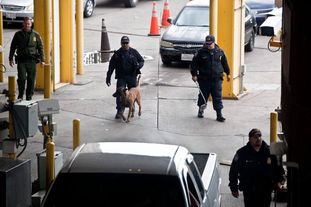 Three CBP officers and a Border Patrol agent work together at the Calexico Port of Entry by searching automobiles and questioning drivers that are coming from Mexico into the U.S.Photographer's Name: Josh Denmark