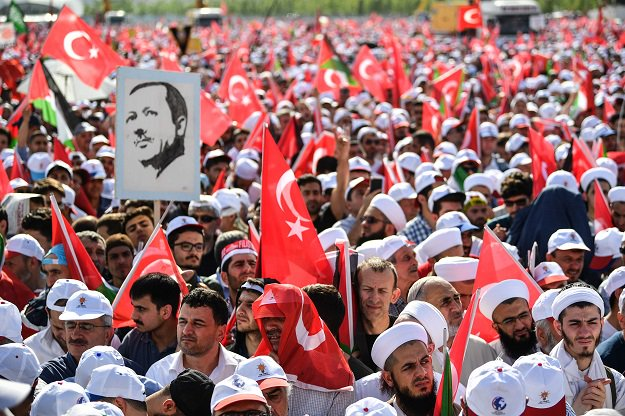 Crowd members look on as they attend a protest rally in Istanbul on May 18, 2018. PHOTO: AFP