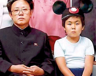 Kim Jong-un with his father.
