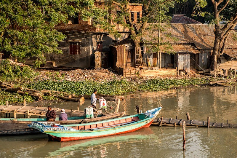 Bangladesh, to the east of India on the Bay of Bengal, is a South Asian country marked by lush greenery and many waterways.