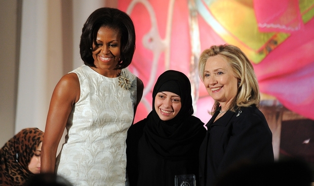 Michelle Obama (left) and Hillary Clinton (right) pose with Samar Badawi of Saudi Arabia as she receives the 2012 International Women of Courage Award (AFP)