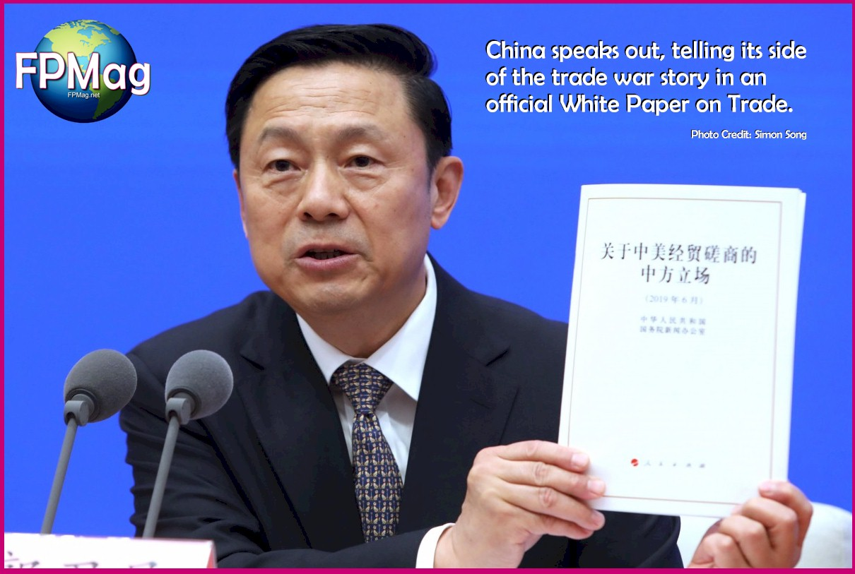 Guo Weimin, of the State Council Information Office presents council's paper on trade war talks with America on Sunday. Photo: Simon Song