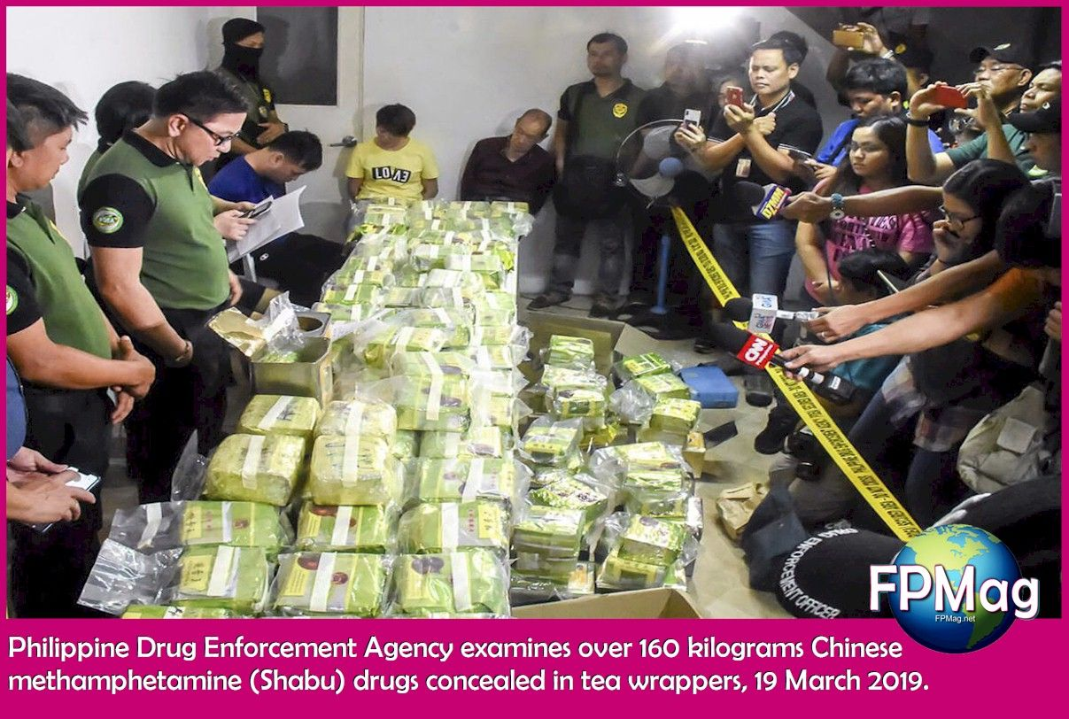 Philippine Drug Enforcement Agency examines over 160 kilograms Chinese methamphetamine (Shabu) drugs concealed in tea wrappers, 19 March 2019.