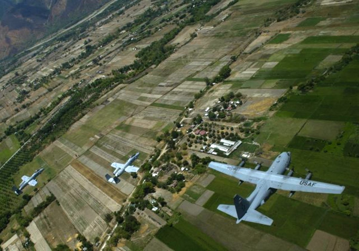 A C-130 Hercules from the USAF 36th Airlift Squadron flies at low altitude with A-10 Thunderbolt IIs from the USAF 25th Fighter Squadron April 27 as part of exercise Balikatan 2015 in Philippines Photo Credit: USAF/Staff Sgt. Nathan Allen