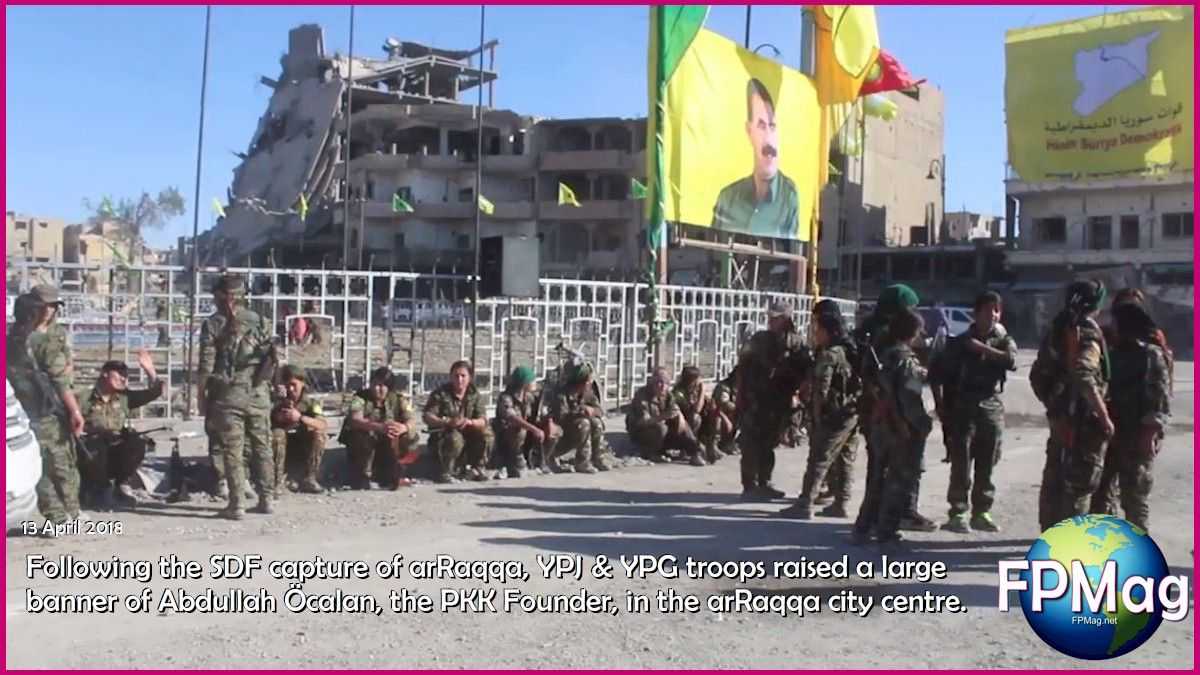 13 April 2018 ~ Following the SDF capture of arRaqqa, YPJ & YPG troops raised a large banner of Abdullah Öcalan, the PKK Founder, in the arRaqqa city centre.