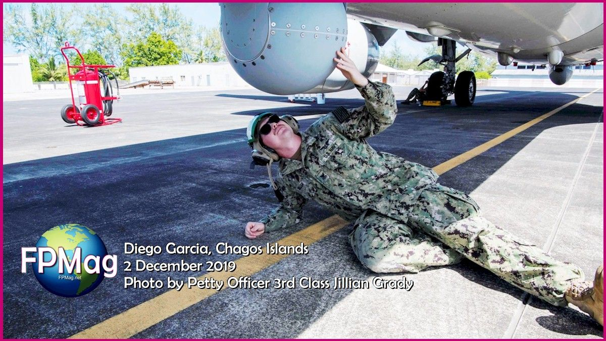 DIEGO GARCIA, British Indian Ocean Territory (Dec. 2, 2019) Aviation Electronics Technician 2nd Class Lake Miller from Patrol Squadron (VP) 45, inspects a Boeing P-8 Poseidon aircraft onboard U.S. Navy Support Facility (NSF) Diego Garcia Dec. 2. VP-45 made a transit stop onboard NSF Diego Garcia Dec. 1 to Dec. 3. (U.S. Navy photo by Mass Communication Specialist 3rd Class Jillian F. Grady)