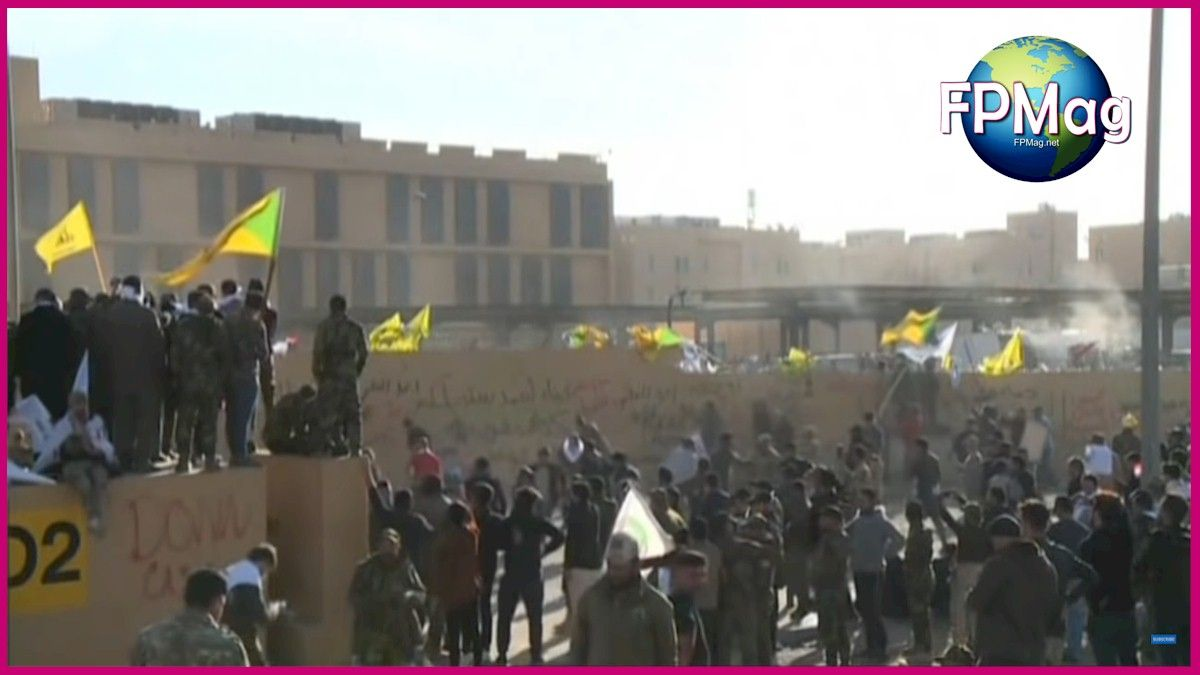 The yellow flags are al-Ḥashd ash-Shaʿbī members and supporters, FPMag's correspondent in Baghdad said.